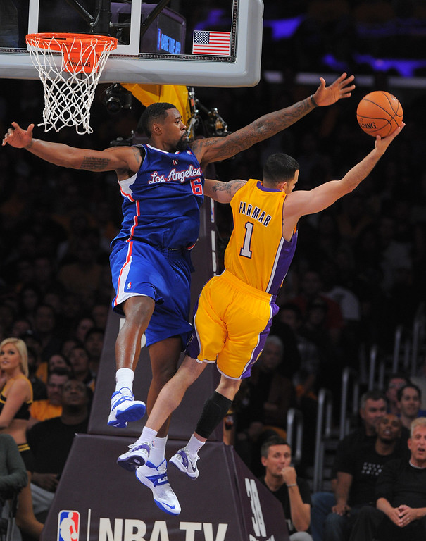 . Clippers DeAndre Jordan puts pressure on Jordan Farmar in the NBA season opener between the Lakers and Clippers at Staples Center in Los Angeles, CA on Tuesday, October 29, 2013.  Lakers won 116-103. (Photo by Scott Varley, Daily Breeze)