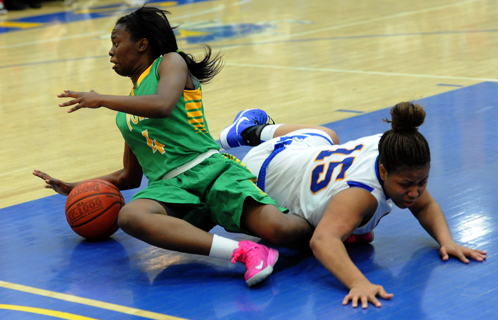 Description of . Long Beach Poly's Tania Lamb (4) scrambles for the loose ball with Bishop Amat's Leeah Powell (15) in the second half of a CIF State Southern California Regional semifinal basketball game at Bishop Amat High School on Tuesday, March 12, 2013 in La Puente, Calif. Long Beach Poly won 52-34.  (Keith Birmingham Pasadena Star-News)