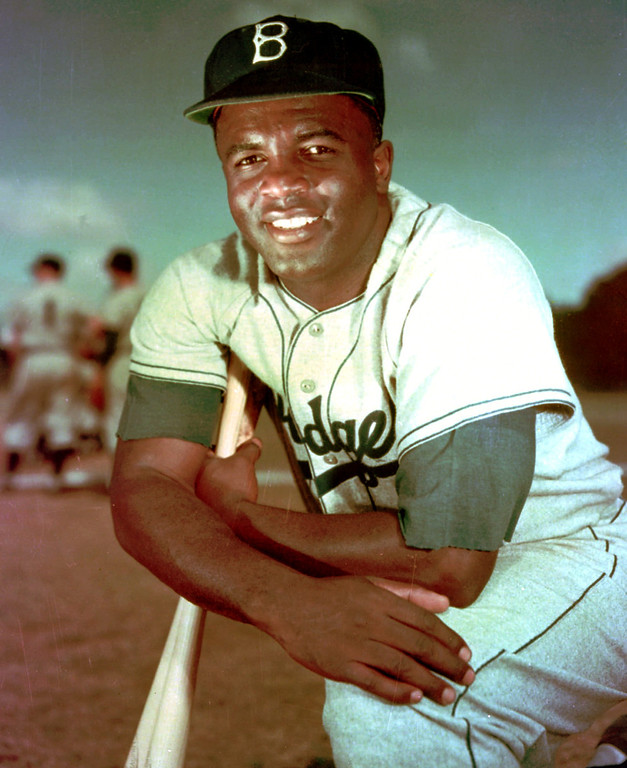 Description of . FILE - Brooklyn Dodgers baseball player Jackie Robinson poses in 1952. Kansas City's Negro Leagues Baseball Museum is hosting an advance screening of an upcoming movie about Robinson, who broke major league baseball's color barrier. Thomas Butch of the financial firm Waddell and Reed announced Wednesday, March 20, 2013 that actors Harrison Ford and Andre Holland will be among those appearing at an April 11 screening of