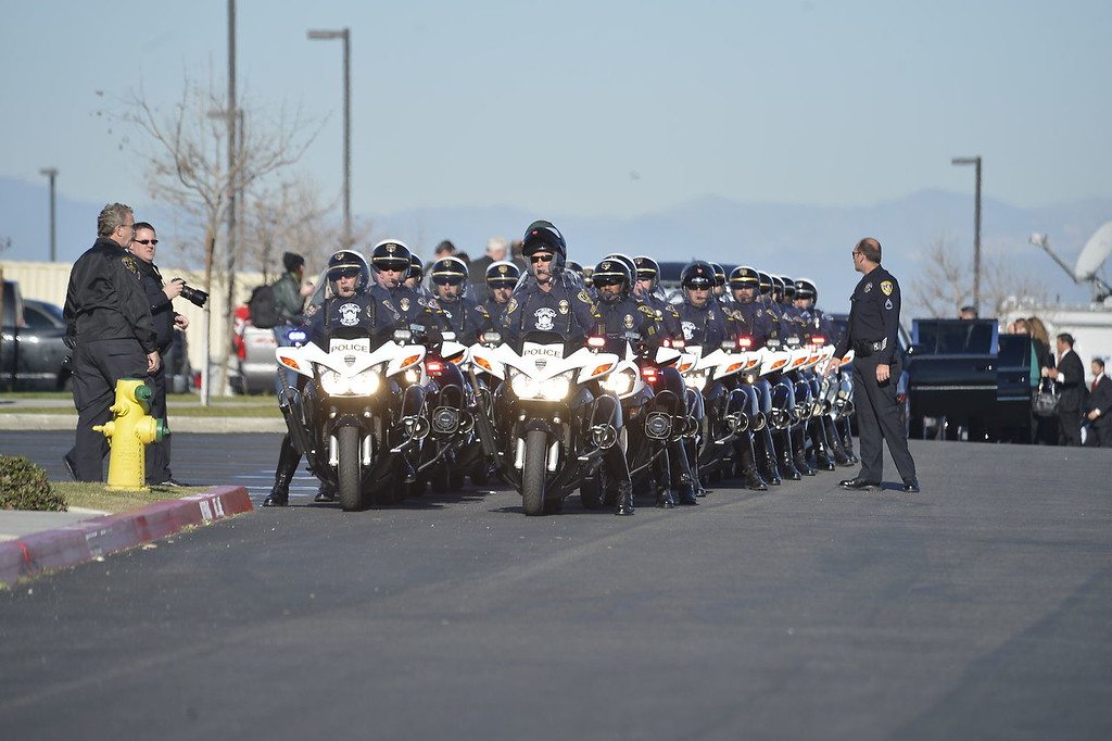 Description of . Procession to Grove Community Church.  Today's funeral for fallen Riverside police Officer Michael Crain to draw thousands, including Gov. Jerry Brown.  The service, to be held at 10:30 a.m. at Grove Community Church, 19900 Grove Community Drive in Riverside, has increased security.  (Jeff Gritchen/Staff Photographer)
