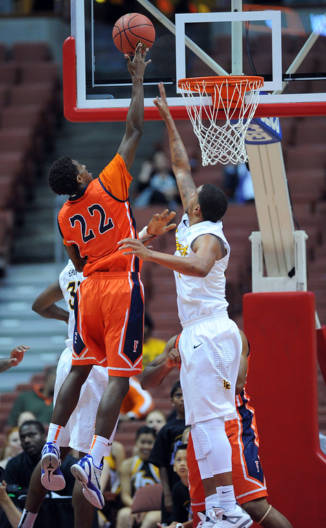 . CSUF\'s Sheldon Blackwell scores at the Honda Center in Anaheim, CA on Thursday, March 13, 2014. Long Beach State vs CSU Fullerton in the Big West men\'s basketball tournament. 1st half. LBSU won 66-56.  Photo by Scott Varley, Daily Breeze)