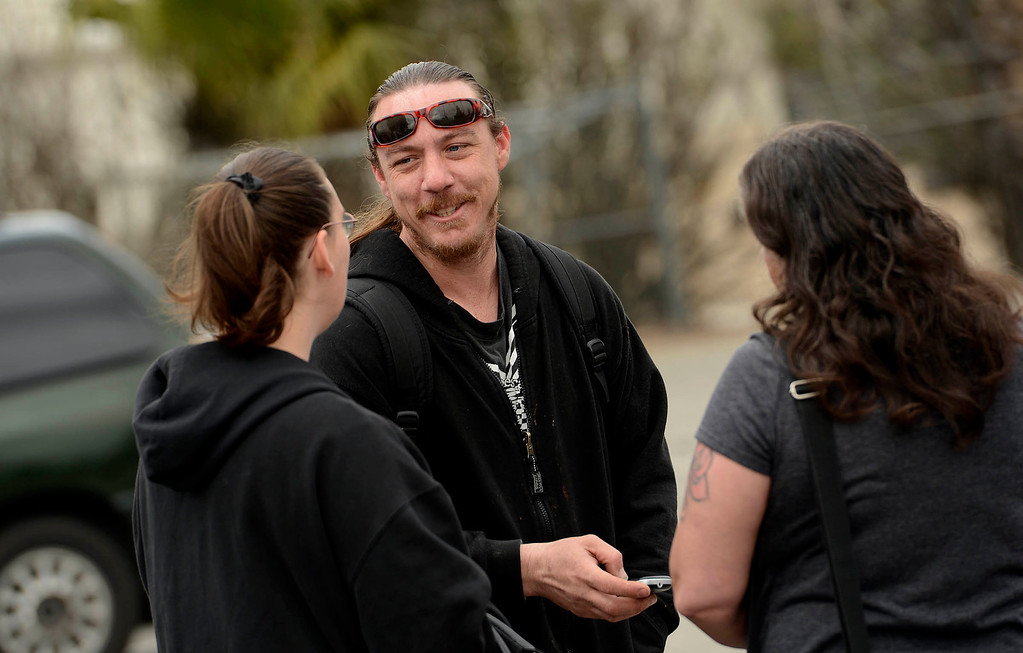 . Dave Thomas, 36, of San Bernardino, speaks to friends prior to being reunited with the dog at the City Animal Shelter in San Bernardino February 19, 2013.  GABRIEL LUIS ACOSTA/STAFF PHOTOGRAPER.
