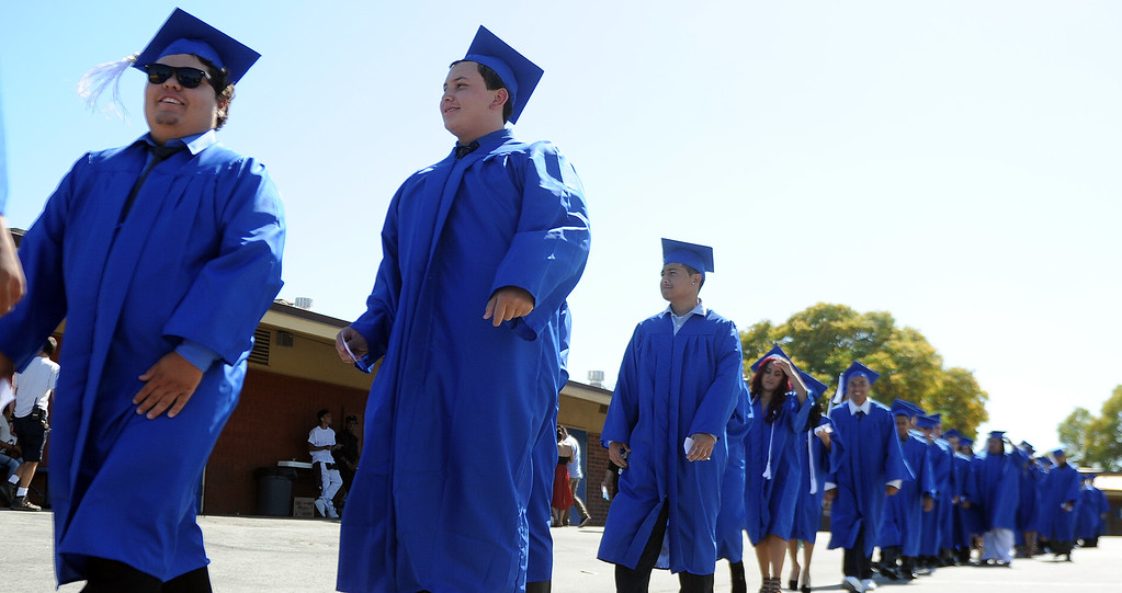 Description of . Students walk in the processional during the El Camino High School commencement at El Camino High School on Wednesday, June 19, 2013 in Whittier, Calif.  (Keith Birmingham/Pasadena Star-News)