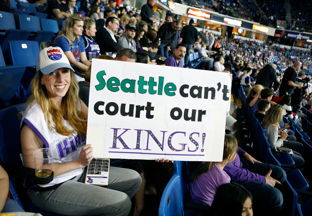 . Sacramento Kings fan Sarah Varanini holds a sign during an NBA basketball game against the Los Angeles Clippers in Sacramento, Calif., on April 17, 2013.(AP Photo/Steve Yeater)