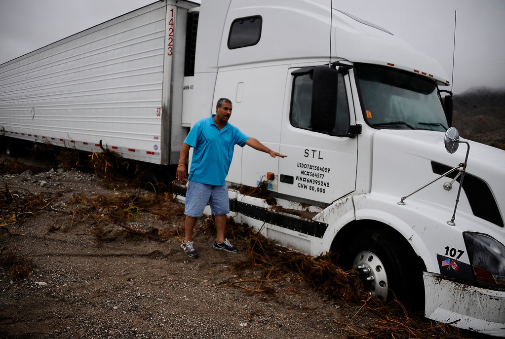 Description of . Drivers in cars and semi trucks got stuck on highway 95 just north of highway 40 west of Needles California Sunday afternoon. Drivers were stuck for hours until Caltrans arrived late in the evening to start to remove the mud that came from heavy monsoon storms today in the deserts areas. Needles CA, Aug 25,2013. Photo by Gene Blevins/LA Daily News