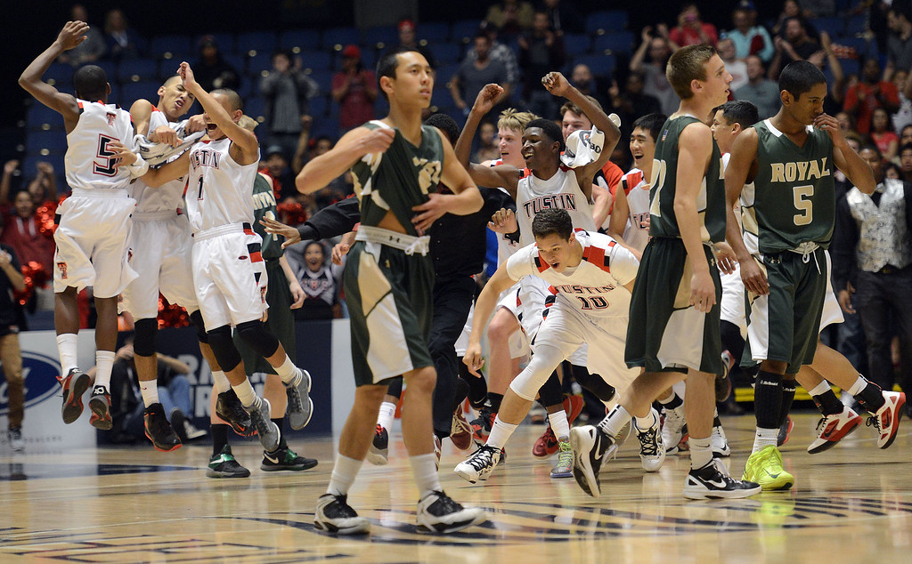 . Tustin players run on to the court as Royal players walk off during their CIF-SS Division III-AAA BoysBasketball Championship at the Anaheim Convention Center Thursday, February 28, 2013. Tustin beat Royal 49-32.  (Hans Gutknecht/Staff Photograpehr)