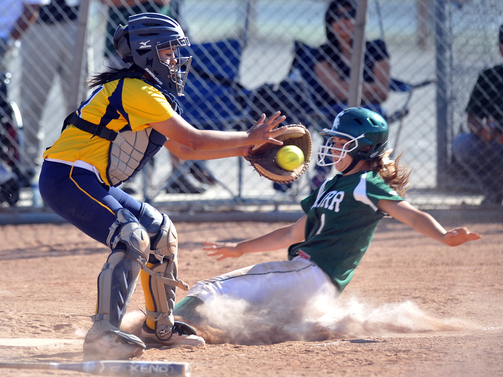 . Montebello catcher Arianna Alvarez (#14) applies a late tag as Schurr\'s Emily Sanchez (#1) slides home safely in their Almont League girls softball game at Montebello High School on Thursday April 18, 2013. Montebello beat Schurr 10-8. (SGVN/Staff Photo by Keith Durflinger)