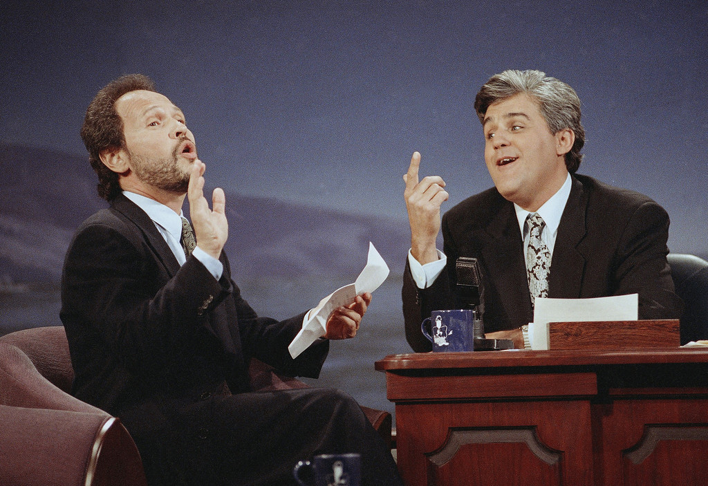 ". Actor/comedian Billy Crystal, left, serenades ""Tonight Show\"" host Jay Leno with \""Dear Mr. Leno\"" during the inauguration of \""The Tonight Show With Jay Leno\"" at NBC Studios in Burbank, May 26, 1992. The song Crystal sang was a parody of Bette Midler\'s ode to Carson on his penultimate show last week. Crystal was Leno\'s first guest. (AP Photo/Craig Fujii)"