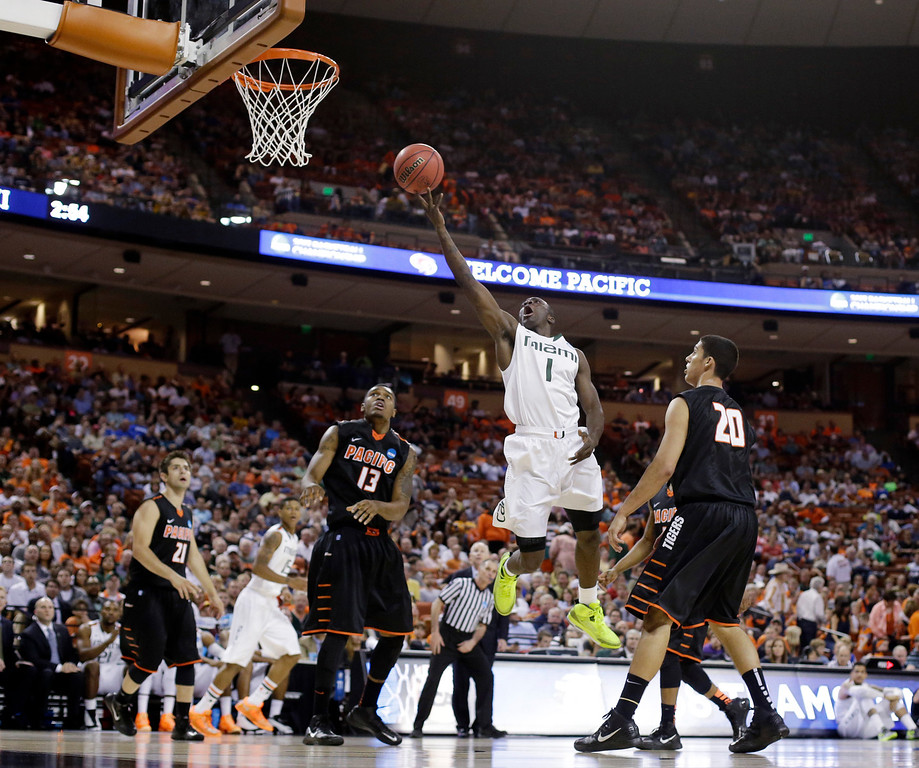 . Miami\'s Durand Scott shoots during the second half of a second-round game of the NCAA college basketball tournament against the Pacific Friday, March 22, 2013, in Austin, Texas. Miami beat Pacific 78-49. (AP Photo/Eric Gay)