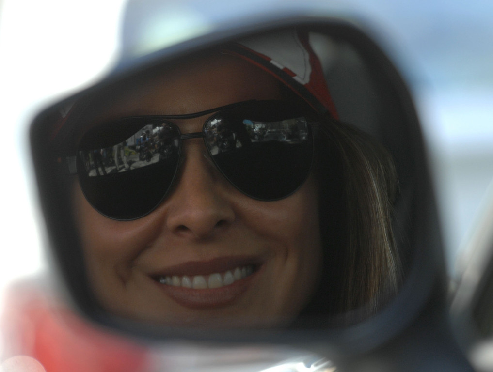 . 4/19/13 - Kate del Castillo gives a smile before the Friday morning practice of the Toyota Pro/Celebrity race at the 39th Annual Toyota Grand Prix of Long Beach. Photo by Brittany Murray / Staff Photographer