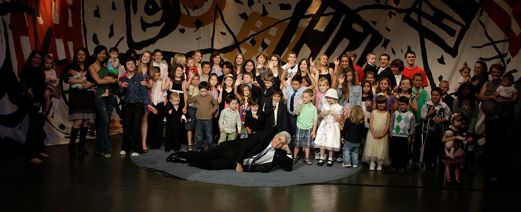 . In this photo provided by NBC, Tonight Show host Jay Leno poses for a photo with the children of the show\'s employees from the past 17 years on Friday, May 29, 2009 in Burbank, Calif. (AP Photo/NBC, Paul Drinkwater) **NO SALES**