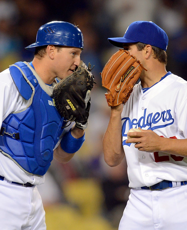 . Los Angeles Dodgers catcher A.J. Ellis and starting pitcher Ted Lilly talk on the mound during the 3rd inning against the Colorado Rockies April 29, 2013 in Los Angeles, CA.(Andy Holzman/Staff Photographer)