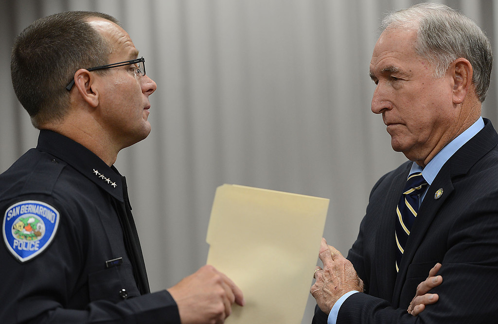 . Rob Handy, left, San Bernardino police chief, and Patrick Morris, mayor of San Bernardino, talk moments before the press conference where Handy announced Jerome Anthony Rogers, 55, of San Bernardino, a registered sex offender, was arrested Friday and booked into West Valley Detention Center in Rancho Cucamonga in the killing of Mary Beth Blaskey. Handy said investigators suspect there is at least one other person involved in the slaying. Rick Sforza/Staff photographer