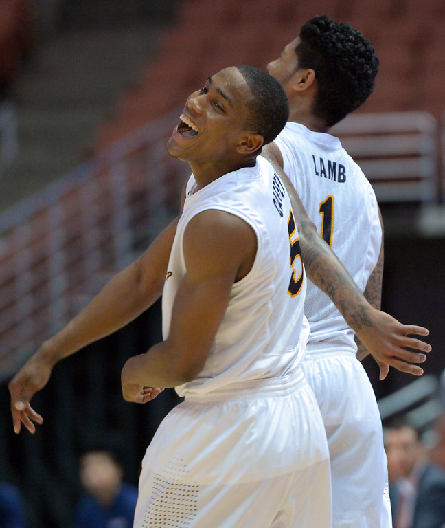 . Mike Caffey begins to celebrate in the final minute for LBSU at the Honda Center in Anaheim, CA on Thursday, March 13, 2014. Long Beach State vs CSU Fullerton in the Big West men\'s basketball tournament. 2nd half. LBSU won 66-56.  Photo by Scott Varley, Daily Breeze)