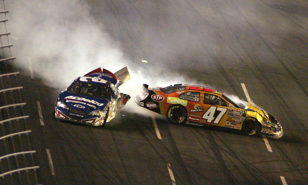 . Driver Clint Bowyer (2) and driver Jon Wood (47) crash coming out of Turn 4 on Saturday, May 27, 2006, during the NASCAR Busch Series Carquest Auto Parts 300 auto race at the Lowe\'s Motor Speedway in Concord, N.C. (AP Photo/Bob Jordan)