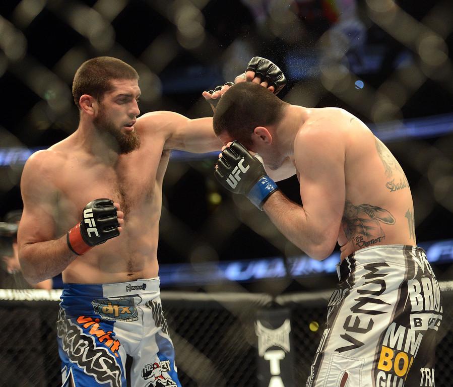 . Court McGee  battles Josh Neer during their UFC 157 match at the Honda Center in Anaheim Saturday, February  23, 2013. McGee  won the fight judges Hans Gutknecht/Staff Photographer)