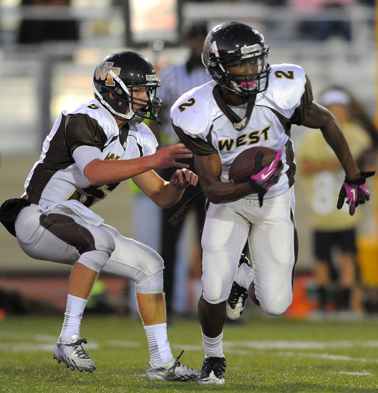 . West High takes on Torrance in a non league football game at Zamperini Stadium in Torrance, CA on Thursday, September 12, 2013. West\'s Brett Ojiyi takes the handoff from Zach Heeger. (Photo by Scott Varley, Daily Breeze)