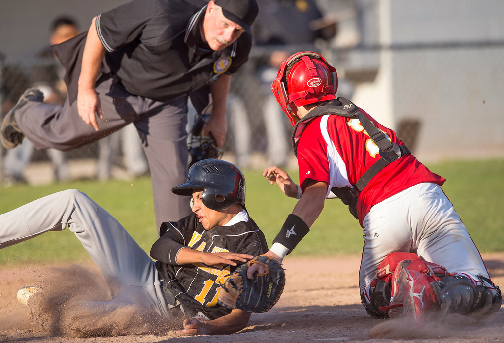 Description of . Santa Fe High's Jacob Ortiz is tagged out at home by Whittier Christian High catcher Cooper Hughes during the sixth inning at Biola University's field in La Mirada March 12, 2013.  (SGVN/Staff photo by Leo Jarzomb)