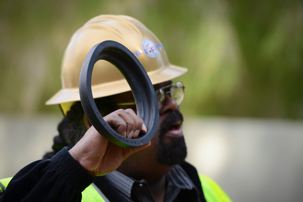 . DWP supervisor Douglas Land holds one of the rubberized joint sections of earthquake proof water pipes being installed along Contour Drive in Sherman Oaks.  The new pipe, made in Japan, has withstood magnitude 9 earthquakes.  Photo by David Crane/Staff Photographer