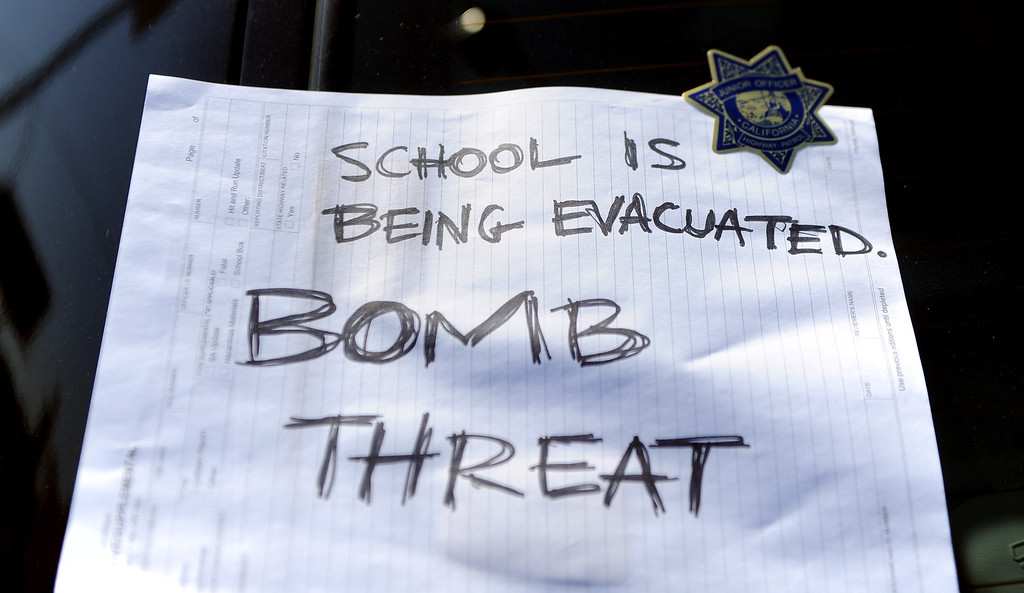 """. A sign on a California Highway Patrol unit reads \""""School is being Evacuated Bomb Threat\"""" as the campus of Cal State Los Angeles was closed due to the threat on Thursday, April 18, 2012 in Los Angeles, Calif.    (Keith Birmingham/Pasadena Star-News)"""