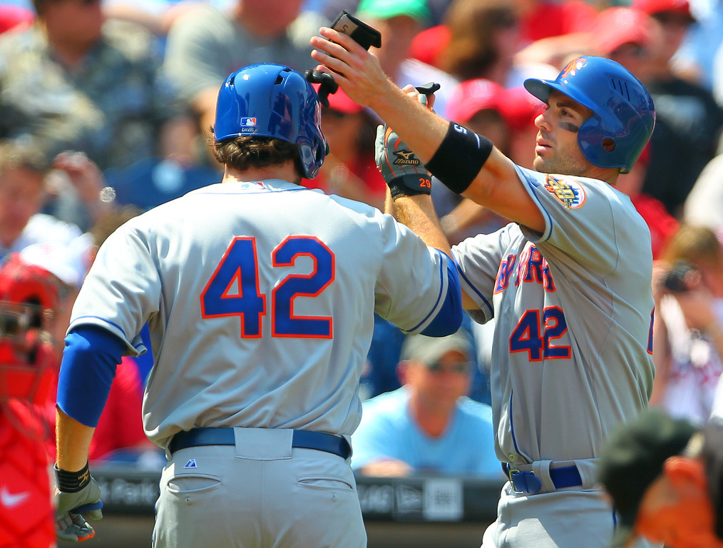 Description of . PHILADELPHIA, PA - APRIL 15: Ike Davis (L) of the New York Mets is congratulated by teammate David Wright after Davis hit a two run-hommer against the Philadelphia Phillies in a MLB baseball game on April 15, 2012 at Citizens Bank Park in Philadelphia, Pennsylvania. To commemorate Jackie Robinson Day, all players and coaches will be wearing #42. (Photo by Rich Schultz/Getty Images)