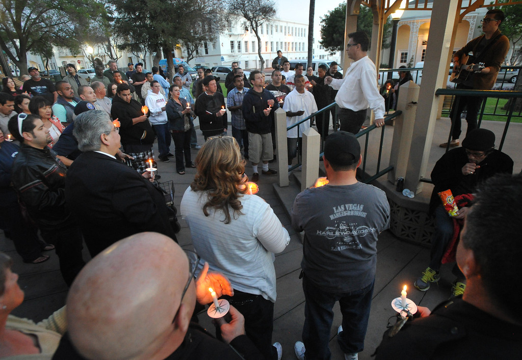 . Pastor Sam Gamboa welcomes residents and community leaders as they gather for a community-wide prayer vigil at Central Park in Whittier in response to recent attempted child abductions on Friday March 15, 2013. About 150 people attended the candlelight vigil led by Pastor Sam Gamboa of the Good Shepherd Family Bible Church and organized by the Whittier Area Evangelical Ministerial Alliance. City and police officials joined citizens and area church members as they prayed for protection of the children and the arrest of the suspects. (SGVN/Staff Photo by Keith Durflinger)
