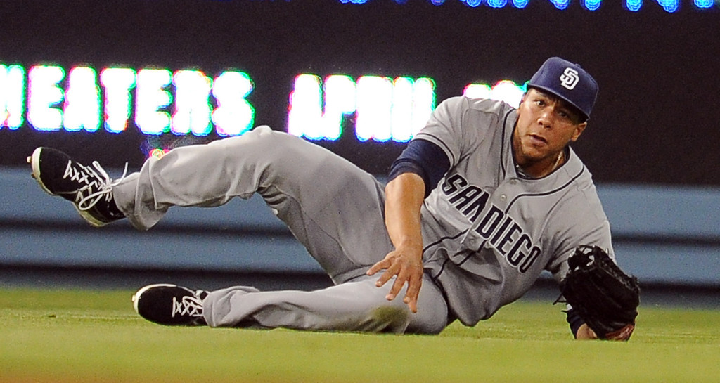 . San Diego Padres left fielder Kyle Blanks makes a sliding catch on a drive by Los Angeles Dodgers\' Andre Ethier (not pictured) in the seventh inning of their baseball game on Wednesday, April 17, 2013 in Los Angeles.   (Keith Birmingham/Pasadena Star-News)