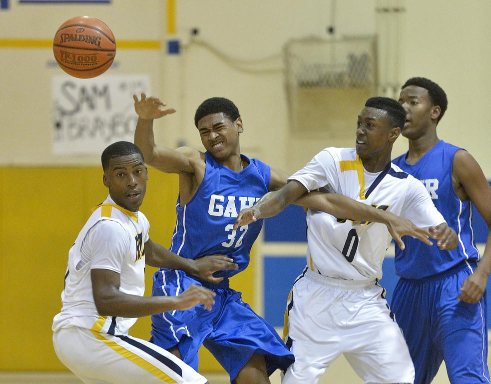 . LONG BEACH, CALIF. USA -- Millikan\'s Mark Thomas (11) and Brian Chambers (0) battle for a loose ball with Gahr\'s David Murrell (32) during their CIF-SS Divison 1-A playoff game in Long Beach on February 15, 2013. Millikan defeated Gahr, 74 to 64. Photo by Jeff Gritchen / Los Angeles Newspaper Group