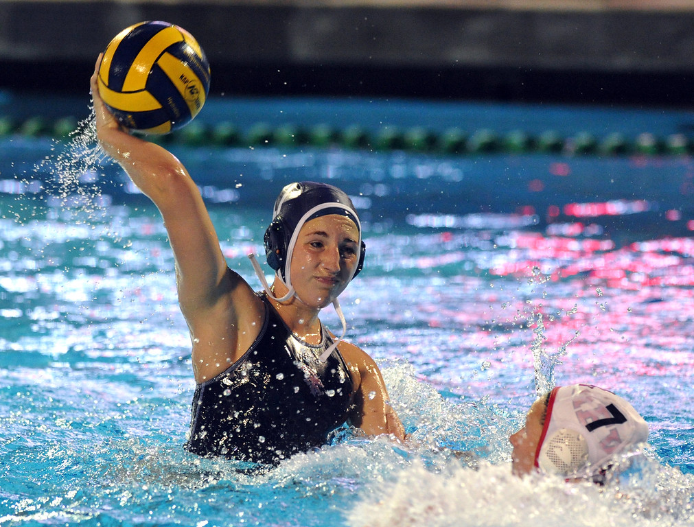Description of . Crescenta Valley's Katie Benson (#17) makes a goal over Redlands East Valley's Allison Wieseler (#7) in the Southern Section Div. V semifinals girls game water polo at Whittier College's Lillian Slade Aquatics Center on Wednesday February 20, 2013. Crescenta Valley beat Redlands East Valley 14-4. (Staff photo by Keith Durflinger)
