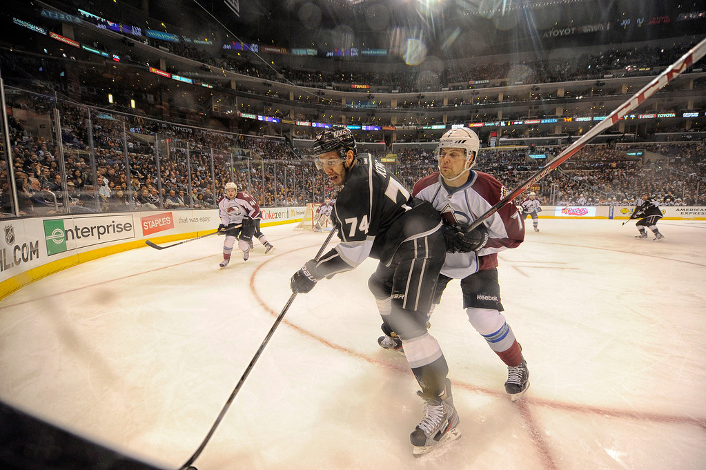 . The Kings\' Dwight King #14 and the Avalanche\'s  John Mitchell #7 battle for the puck during their game at the Staples Center in Los Angeles Thursday, April 11, 2013.(Hans Gutknecht/Staff Photographer)