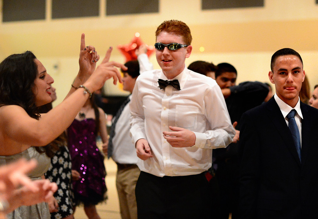 Description of . David Napolitano, center, dances during Glendora High School's Best Buddies Prom for high school students with special needs Friday night, April 19, 2013 at the Glendora campus. (SGVN/Staff Photo by Sarah Reingewirtz)