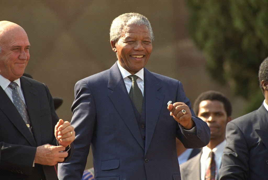 ". President Nelson Mandela dances at a celebration concert following his inauguration at the Union Buildings in Pretoria, South Africa, Tuesday, May 10, 1994, along with former President F.W. de Klerk.  ""Never, never, and never again shall it be that this beautiful land will again experience the oppression of one by another and suffer the indignity of being the skunk of the world,\""  Mandela vowed.  (AP Photo/John Parkin)"