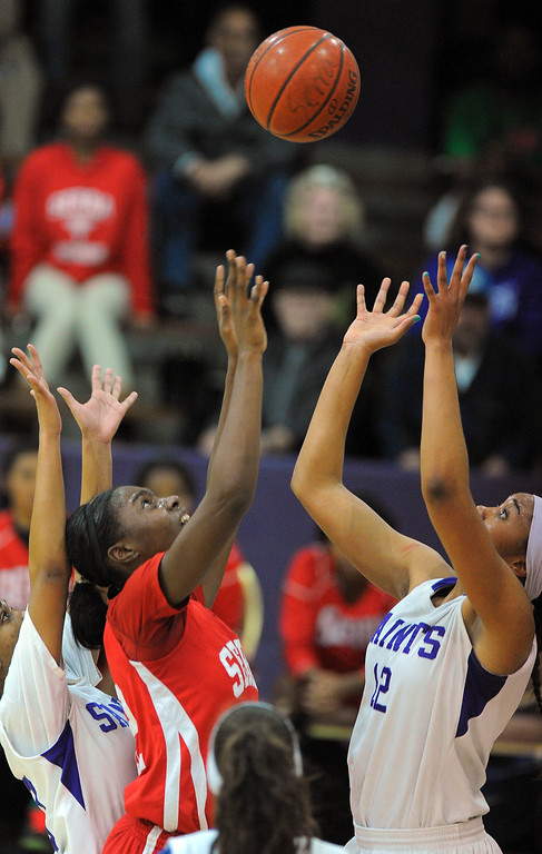 . LONG BEACH - 02/20/13 - (Photo: Scott Varley, Los Angeles Newspaper Group)  Serra and St. Anthony meet in the Quarterfinals of the Division 4AA CIF-SS girls basketball playoffs. Serra won 58-45. Serra\'s Tatiana Howard, left, has her shot blocked and stolen by Kendall Cooper.