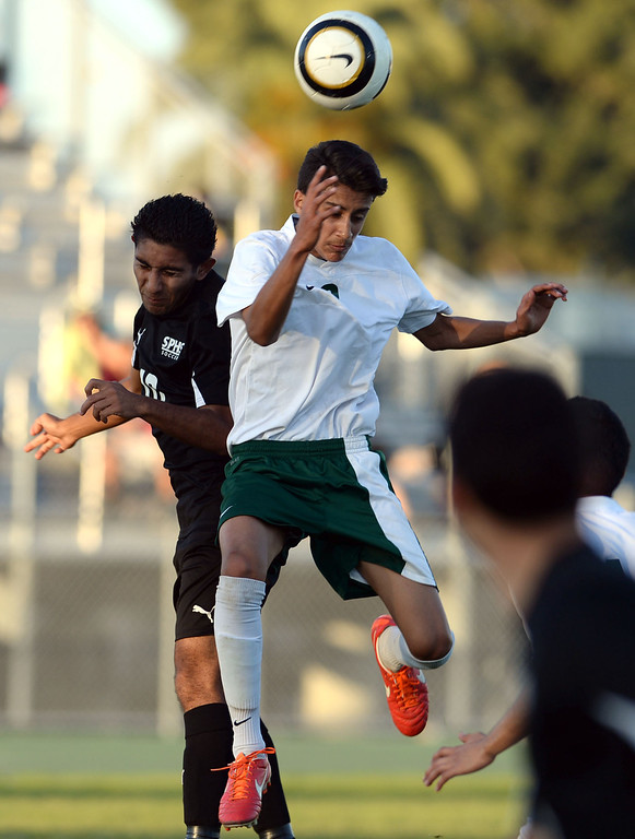 . Narbonne\'s Jaime Enriquez (8) gets to the ball ahead of San Pedro\'s Andres Toribio (10) in a Marine League boys soccer game Wednesday, February 12, 2014, Harbor City, CA.  Narbonne won 2-0 and seals the league title. Photo by Steve McCrank/Daily Breeze