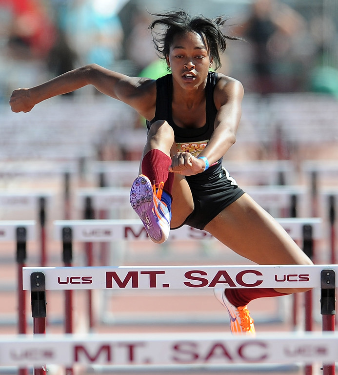Description of . Skylin Harbin of Alemany competes in the 100 meter hurdles invitational high school during the Mt. SAC Relays in Hilmer Lodge Stadium on the campus of Mt. San Antonio College on Saturday, April 20, 2012 in Walnut, Calif.    (Keith Birmingham/Pasadena Star-News)