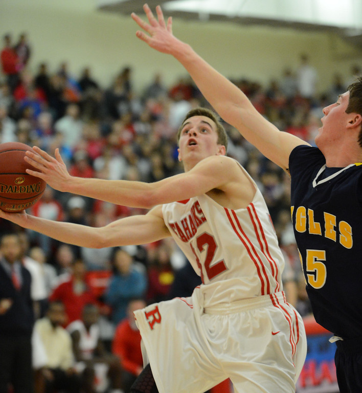 . Redondo Union\'s Ian Fox (32) shoots around Arroyo Grande\'s Andrew Midyett (25) on his way to the basket in a CIF Southern Section Division II-A semifinal boys basketball game Tuesday night in Redondo Beach. 20130226 Photo by Steve McCrank / Staff Photographer
