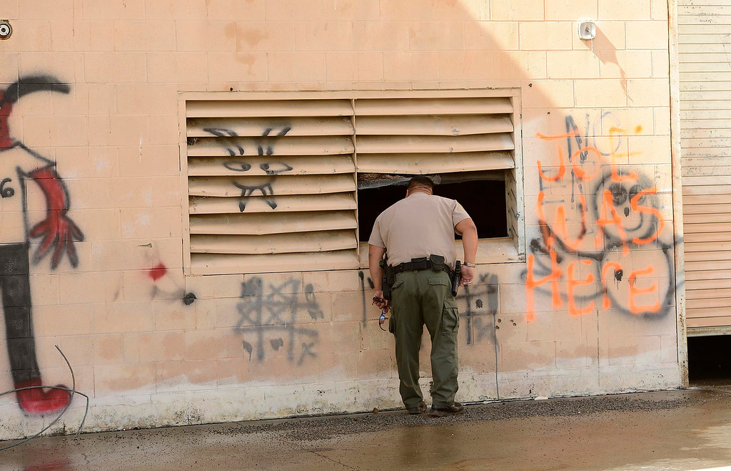 . California Department of Fish and Wildlife Warden Kyle Chang patrols some vacant buildings in the San Jacinto Wildlife Area in Hemet March 8, 2013.  GABRIEL LUIS ACOSTA/STAFF PHOTOGRAPHER.