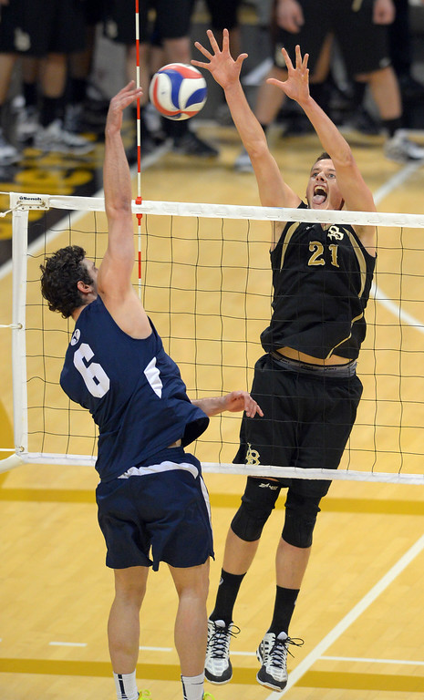 . BYU\'s Josue Rivera hits around LBSU\'s Connor Olbright in Long Beach, CA on Friday, March 7, 2014 #2 BYU vs #3 Long Beach State men\'s volleyball at Walter Pyramid. (Photo by Scott Varley, Daily Breeze)