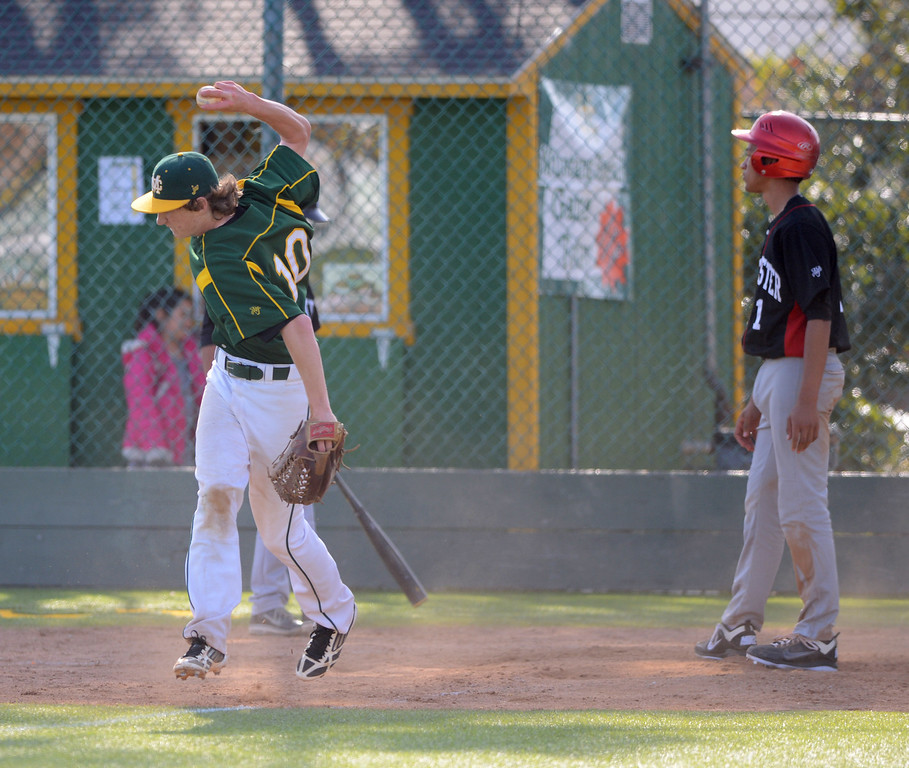 . MC #10 pitcher Christian Reynolds spikes the ball after tagging out Westchester runner Grant Craddolph, right, at the plate in the 5th inning. Mira Costa defeated Westchester 2-1 at home in boy\'s baseball.  Photo by Brad Graverson 3-26-13