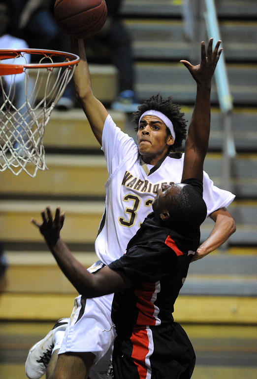 . TORRANCE - 02/15/2013 - (Staff Photo: Scott Varley/LANG) In a CIF Southern Section Division III-AAA second-round boys basketball matchup, West beat Hart 64-55. West\'s Xavier Basso gets fouled on a dunk by Stanley Wilder.