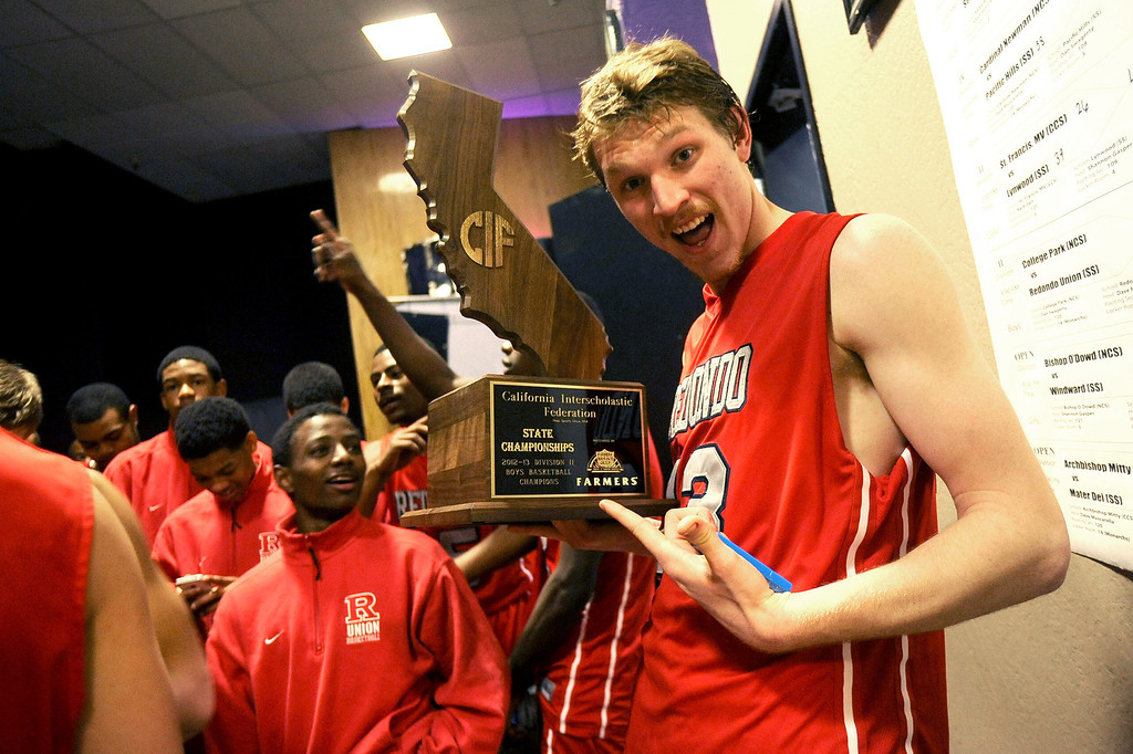 . Redondo Union High School\'s Sebastian Lindner shows off the championship trophy after defeating College Park High School during the Division II 2013 CIF State Basketball Championships at Sleep Train Arena, in Sacramento, Ca March 23, 2013.  Redondo won the game 54-47.(Andy Holzman/Los Angeles Daily News)