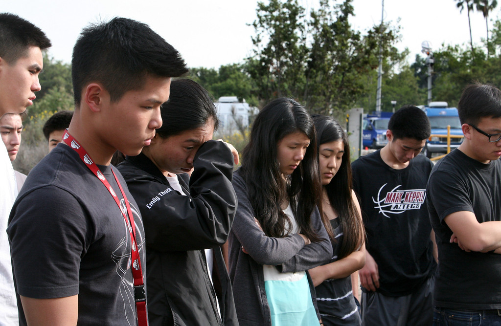 . Students from Mark Keppel High School gather on Monday March, 25, 2013, to remember their 17-year-old friend Esther Suen, who was killed in a hiking accident in Eaton Canyon on Friday. She is among a long line of recent fatalities in Pasadena\'s recreational backyard. An 18-year-old man with Suen was seriously injured. (Pasadena Star News / Correspondent photo by Nancy Newman)