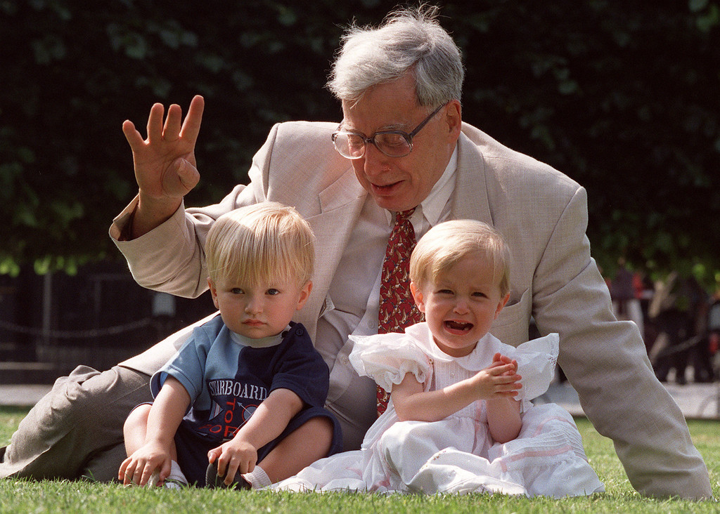 . FILE- The British pioneer of IVF treatment, Professor Robert Edwards sits with two of his \'test-tube-babies\', Sophie and Jack Emery who celebrate their second birthday in London in this file photo dated Monday July 20, 1998. The Nobel prize winner for medicine,  Edwards who was a pioneer of in-vitro fertilization, which became known as test tube babies, has died aged 87, it is announced Wednesday April 10, 2013. (AP Photo/Alastair Grant, File)