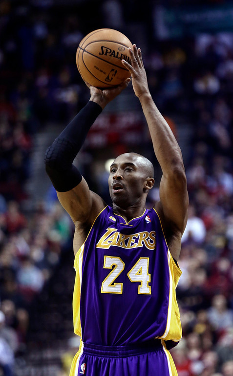 . Los Angeles Laker guard Kobe Bryant shoots during the first quarter of an NBA basketball game against the Portland Trail Blazers in Portland, Ore., Wednesday, April 10, 2013.(AP Photo/Don Ryan)