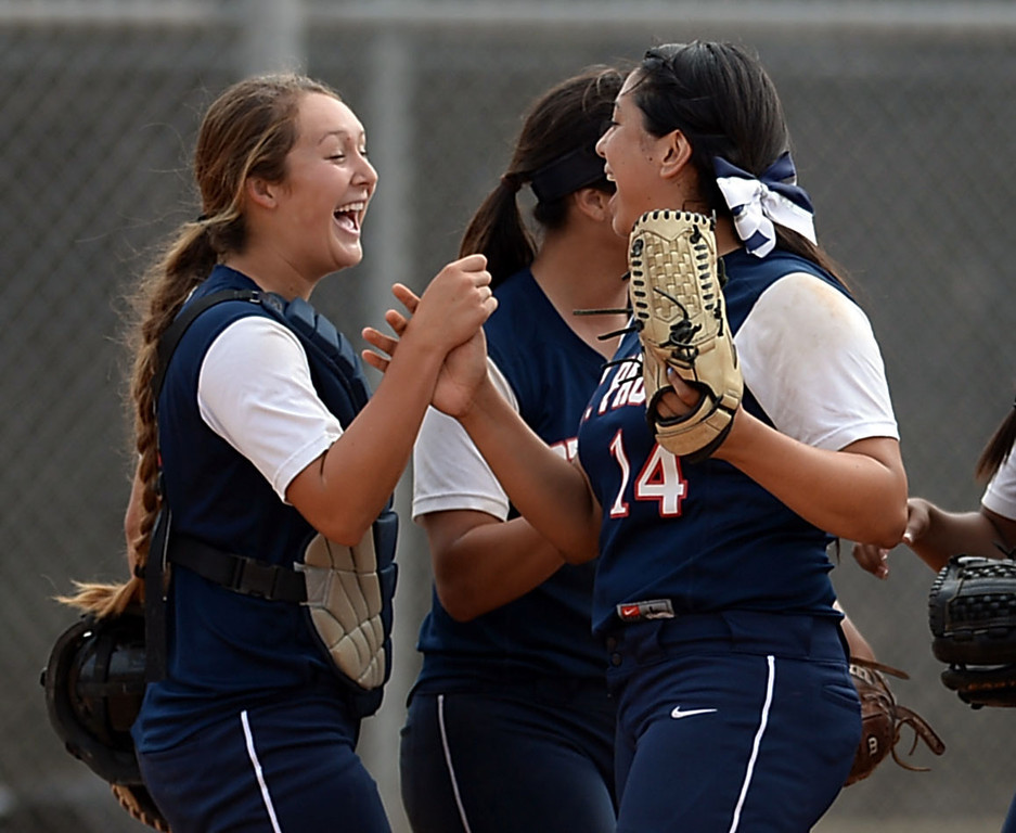 . St. Paul catcher Dominique Walker (1) and pitcher Koreen Orozco (14) celebrate their win in a CIF-SS Division III semifinal softball game Tuesday, May 27, 2014, Palos Verdes Estates, CA.   Palos Verdes lost 10-0. Photo by Steve McCrank/Daily Breeze