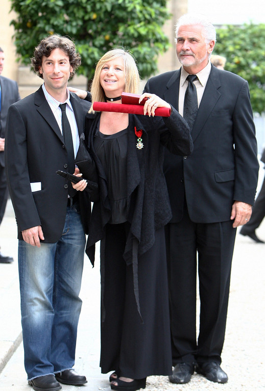 . Paris, FRANCE: US singer Barbra Streisand poses with her husband James Brolin and her son Jason as she leaves the Elysee Palace after being awarded by French President Nicolas Sarkozy as Officer of France\'s Legion d\'Honneur order (legion of honnor), 28 June 2007 at in Paris.  (MEHDI FEDOUACH/AFP/Getty Images)