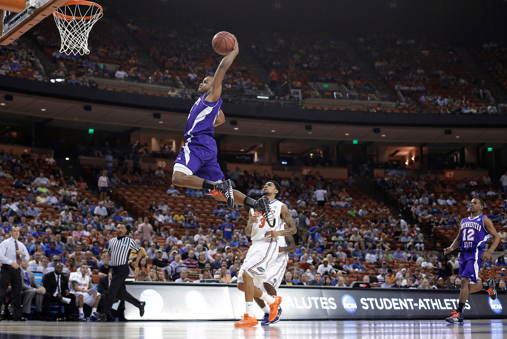 . Northwestern State\'s Brison White, left, drives to the basket over Florida\'s Mike Rosario (3) during the first half of a second-round game of the NCAA men\'s college basketball tournament Friday, March 22, 2013, in Austin, Texas.  (AP Photo/Eric Gay)