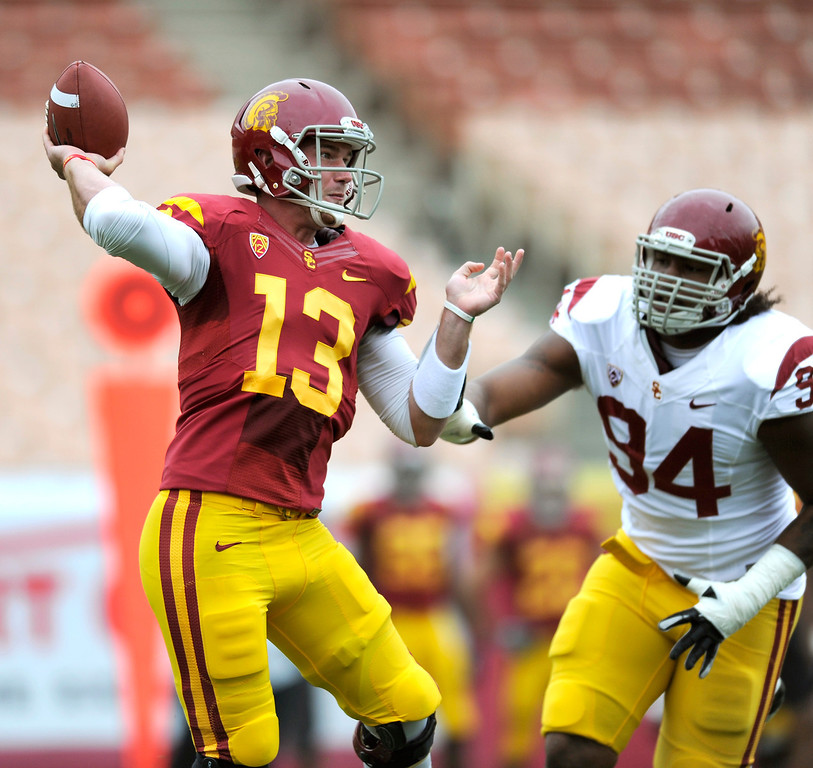 . QB Max Wittek passes under pressure from DT Leonard Williams during USC\'s Spring Football Game at the L.A. Memorial Coliseum, Saturday, April 13, 2013. (Michael Owen Baker/Staff Photographer)