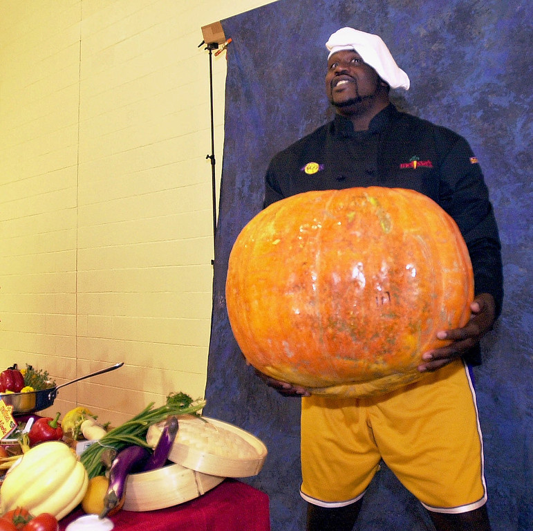 . Los Angeles Lakers\' Shaquille O\'Neal holds a giant pumpkin as he poses for photos for a new Lakers cookbook during media day Friday, Sept. 28, 2001, at HealthSouth Training Center in El Segundo, Calif. O\'Neal, who had surgery Aug. 29 to alleviate the ache in his small left toe, said Friday he\'s not sure he\'ll be ready to play when the two-time defending NBA champion Lakers begin the season Oct. 30 against Portland. (AP Photo/Ric Francis)