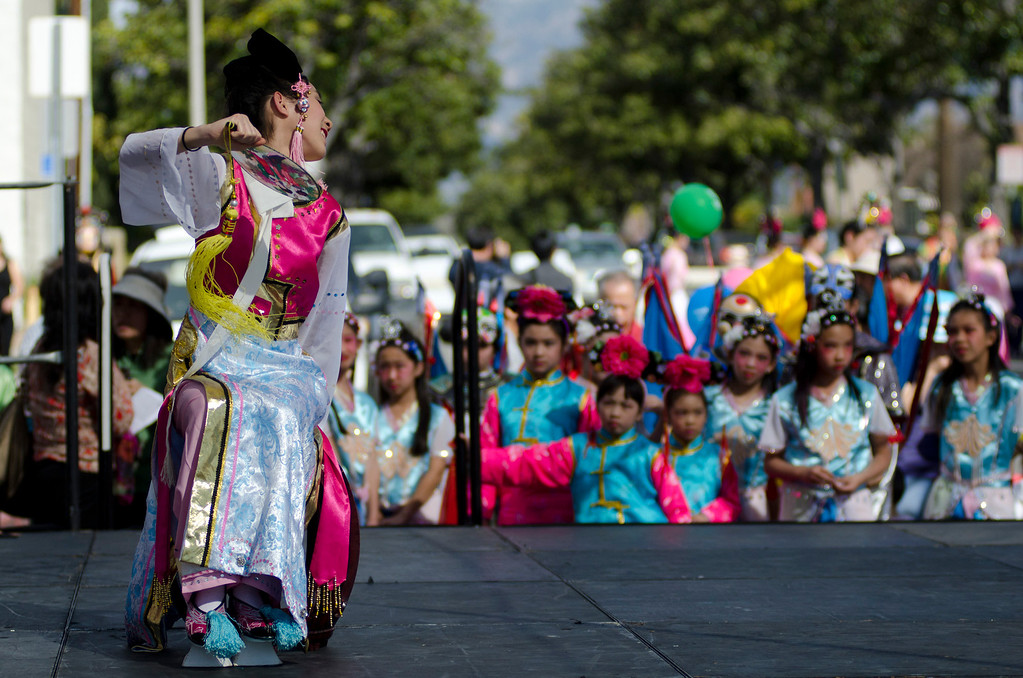 . A performer tilts her head to look at the crowd during the 22nd Annual Alhambra Lunar New Year Celebration in Alhambra, Calif., Saturday, Feb. 16, 2013. The festival included food, rides, games and entertainment.